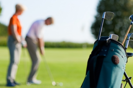 woman golf: Mature or senior couple playing golf Stock Photo