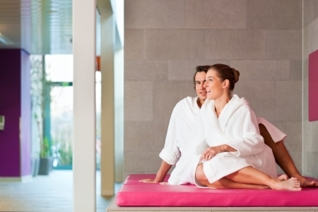 woman bathrobe: Young couple in bathrobe in Spa, they presumably having their honeymoon Stock Photo