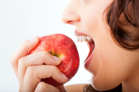 apple bite: Healthy nutrition and healthy teeth or diet, young woman bites in a apple Stock Photo