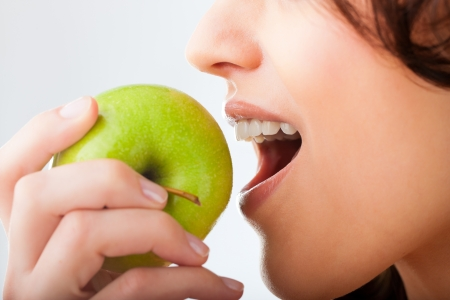 woman apple: Healthy nutrition and healthy teeth or diet, young woman bites in a fresh apple