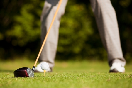Golfer both feet to be seen - doing a golf stroke, he is playing on a wonderful summer afternoon Stock Photo - 14124170