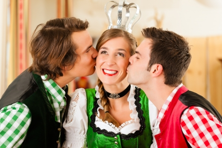 tracht: Young people in traditional Bavarian Tracht in restaurant or pub having fun and making jokes