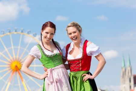tracht: Young women in traditional Bavarian clothes - dirndl or tracht - on a festival or Oktoberfest