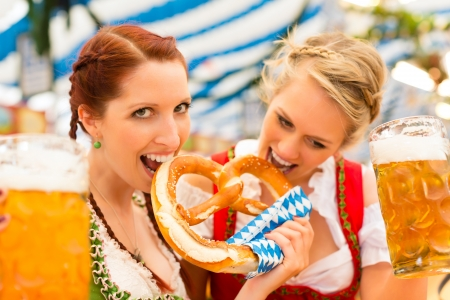 tracht: Young women in traditional Bavarian clothes - dirndl or tracht - on a festival or Oktoberfest in a beer tent