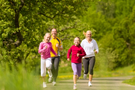 jogging in nature: Family jogging for sport outdoors with the kids on summer day