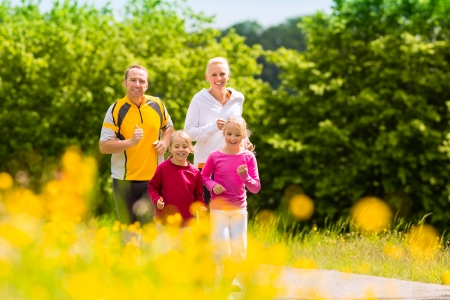 family exercise: Family jogging for sport outdoors with the kids on summer day