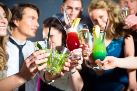 Young people in club or bar drinking cocktails and having fun Stock Photo - 15479916