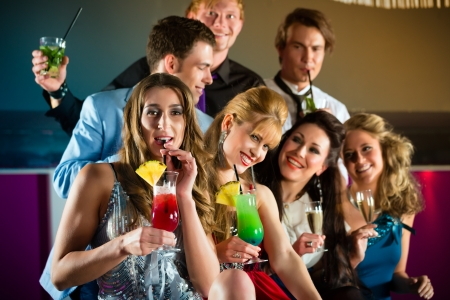 Young people in club or bar drinking cocktails and having fun Stock Photo - 15479893