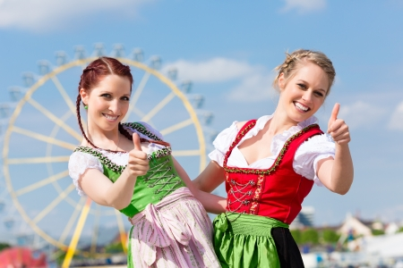 wiesn: Young women in traditional Bavarian clothes - dirndl or tracht - on a festival or Oktoberfest