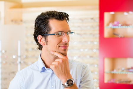 might: Young man at optician with glasses, he might be customer or salesperson