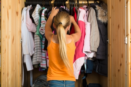 wardrobes: Family - child or teenager in front of her closet or wardrobe and looking for outfit Stock Photo