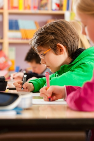 school form: Education - Pupils at primary or elementary school doing their homework or having a school test