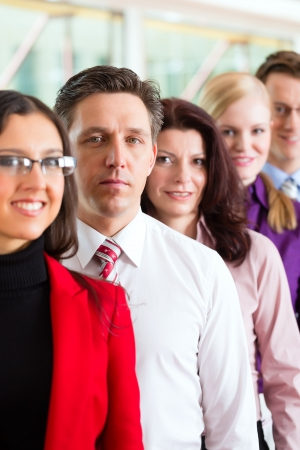 department head: Business people or team in office looking to the viewer Stock Photo