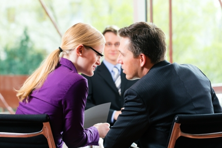 Business - young man as applicant sitting in job interview with future boss and HR Stock Photo - 15784991