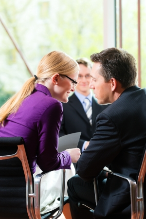 Business - young man as applicant sitting in job interview with future boss and HR Stock Photo - 15785003