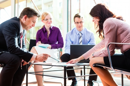 counsel: Business people having meeting or workshop in office  Stock Photo