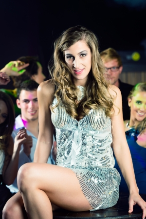 lascivious: Young people dancing in club or disco and have party; the girls and boys, friends, having fun