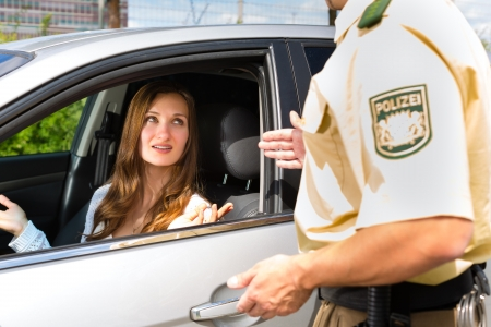 traffic police: Police - young woman with policeman or cop on the street or traffic Stock Photo