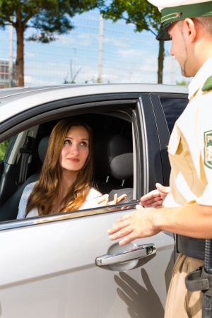 a policeman: Police - young woman with policeman or cop on the street or traffic Stock Photo