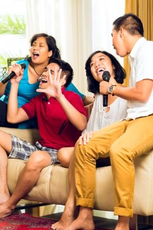 indonesia people: Asian people singing at karaoke party and having fun