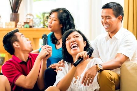 karaoke singer: Asian people singing at karaoke party and having fun