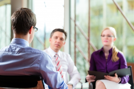 job occupation: Man having an interview with manager and partner employment job candidate hiring resume CEO work