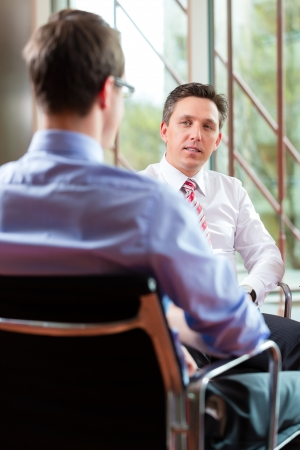 Man having an interview with manager employment job candidate hiring resume CEO work business photo
