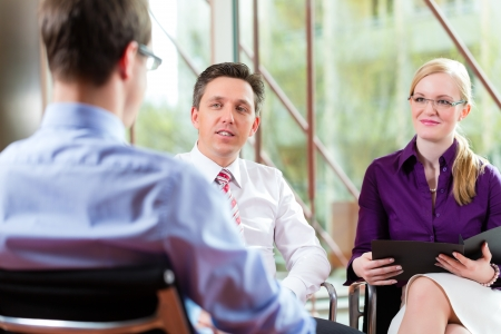 Man having an interview with manager and partner employment job candidate hiring resume CEO work business Stock Photo - 16011571