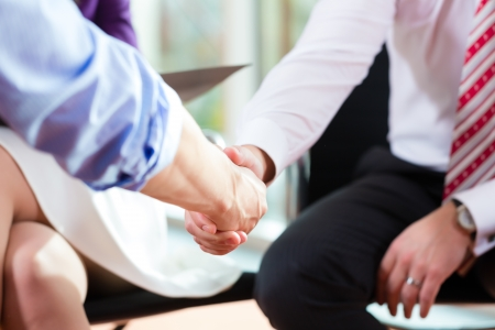 Man shaking hands with manager at job interview closeup cutout employment candidate hiring resume CEO work business photo