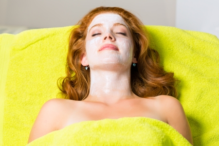 Cosmetics and Beauty - woman with facial mask in Wellness Spa photo