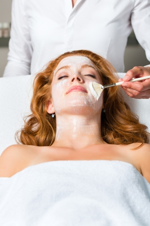Woman having a mask or cream applied in the course of a beauty or wellness treatment photo