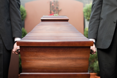 casket: Religion, death and dolor  - funeral and cemetery; funeral with coffin Stock Photo