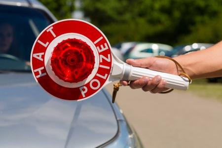 radar: Police - policeman or cop in uniform stop car in traffic control