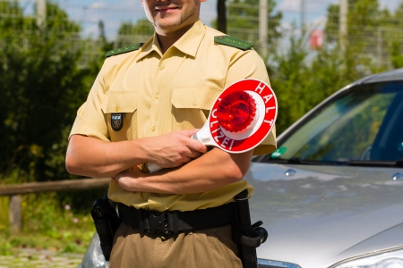 traffic police: Police - policeman or cop in uniform stop car in traffic control