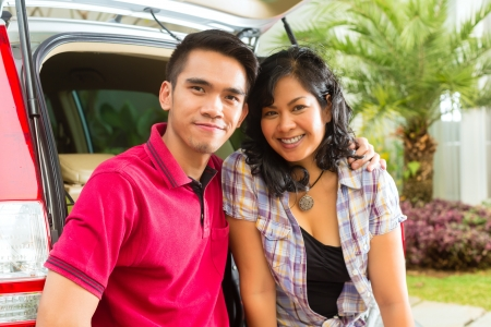 Asian couple is happy in front the car and ready to go on vacation Stock Photo - 16883729