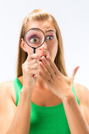 Woman looking through magnifying glass or loupe Stock Photo - 16883830