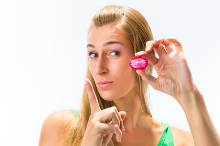 Young woman with a condom Stock Photo - 16883910