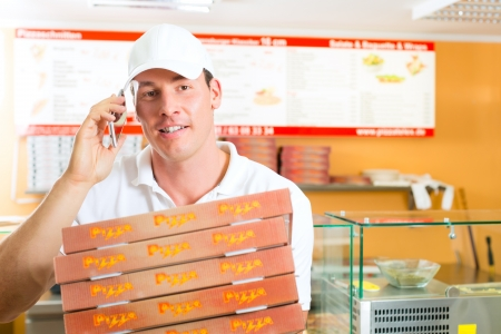 delivery service: Man holding several pizza boxes in hand and asking you to order pizza for delivery
