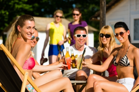 People at beach drinking having a party, friends clinking glasses with cocktails and beer having fun Stock Photo - 17067473