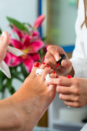 day spa: Woman receiving pedicure in a Day Spa, feet nails get polish