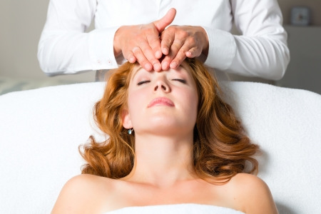 Wellness - woman getting massage in Spa, it is a massage for the head or face Stock Photo - 17058445