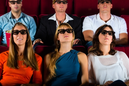 young people strained watching 3d movie at movie theater photo