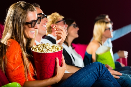 young people watching 3d movie at movie theater Stock Photo - 17058414