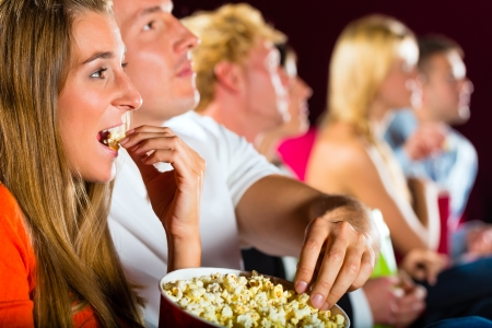 watching movie: young people watching movie at movie theater Stock Photo