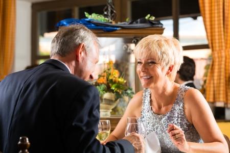 Dining: Senior couple fine dining food at table in hotel or elegant restaurant
