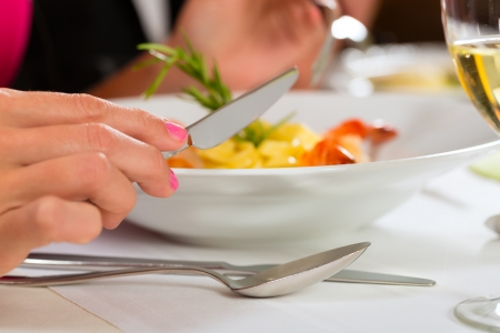 renowned: People fine dining food at table in hotel or elegant restaurant