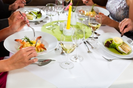 People fine dining food at table in hotel or elegant restaurant  photo