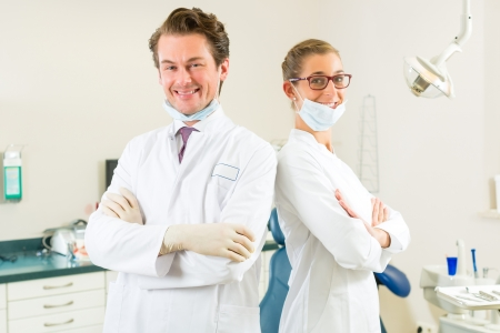Dentists in their surgery looking at the viewer standing side by side Stock Photo - 17058466