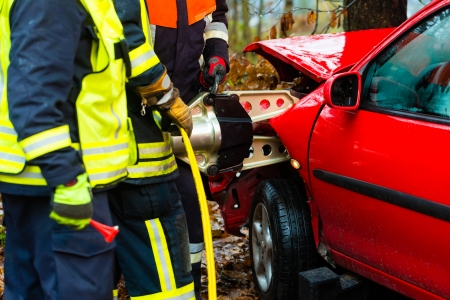 brigade: Accident - Fire brigade rescues accident Victim of a car using a hydraulic rescue tool