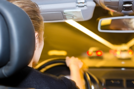 Young woman, drives trough tunnel with her car on motorway Stock Photo - 17109081
